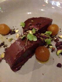 Chocolate Cardomom Terrine, ground coffee, pistachio, poached pear