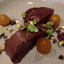 Chocolate Cardomom Terrine, ground coffee, pistachio, poached pear