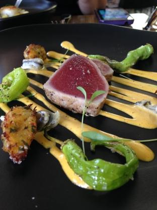 Seared yellow fin tuna, salt cod fritter, Lombardo peppers and saffron dressing