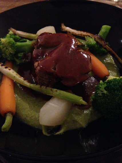 Slow cooked lamb shoulder with broccoli purée