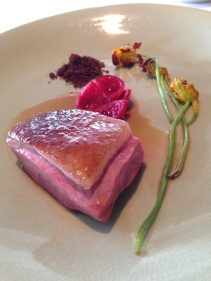 Aged Pekin duck wood roasted on the bone, quandong, dried liver