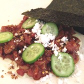 Spicy Wagyu beef tartare with puffed rice, cucumber and nori