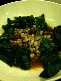 Borlotti beans and calamari cooked in crab sauce with bean leaves