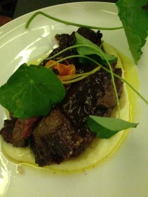 Grilled beef hanger steak with potato sauce, dripping and pickled nasturtium
