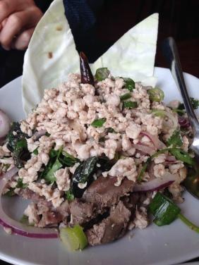 Northeastern larp salad with liver, kidneys and chicken skin