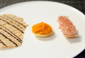 Snacks - Oat cracker with oyster cream and black garlic, Sour cream and trout tartlet, Rye biscuit, lardo, kohlrabi, apple