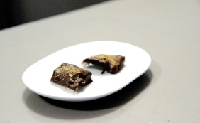 Puffed pork skin in dark chocolate with candy fennel seeds and pollen