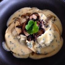 Mushroom ravioli, celeriac puree, white wine, sage