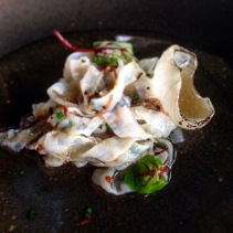 Shaved squid, dried chicken, herbs, white onion, smoked pork fat