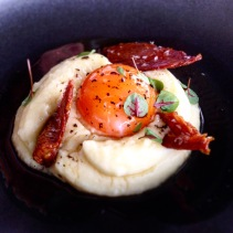 Slow cooked duck egg, potato, truffle, chicken skin