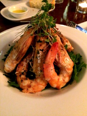 Spencer Gulf Prawns, flambéed with Ricard, garlic and parsley, served on rocket and fennel, drizzled with lemon and lime