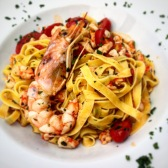 Tagliatelle with prawn sauce and tomatoes