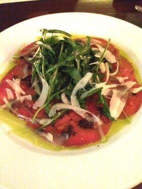 Carpaccio di Manzo with basil, diced tomato, black olives, grana padano