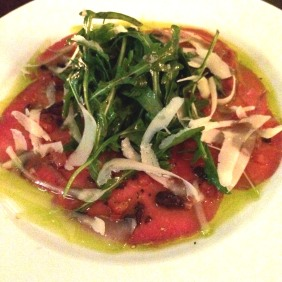 Carpaccio di Manzo with basil, diced tomato, black olives, grana padano