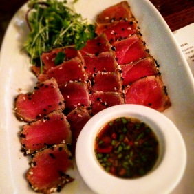 Tuna Tataki marinated in soy with sesame and poppy seeds, pan seared, with a soy chilli and lime dipping sauce