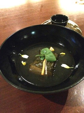 Grapefruit leaf wrapped tofu in bonito broth