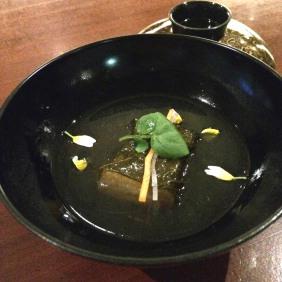 Grapefruit leaf wrapped tofu in bonito broth