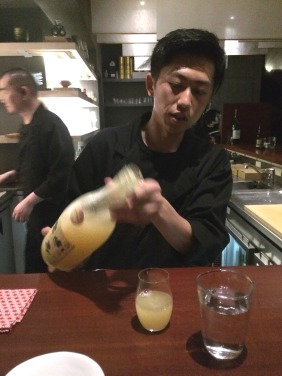 Our waiter, Kentaro, pouring our 'Yuzucello'