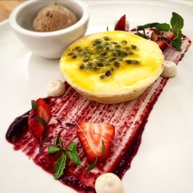 Passionfruit and lemon curd tart with clove, cinnamon and cognac icecream