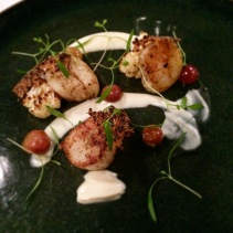 Seared scallops, barbecued cauliflower, red grapes, curry salt