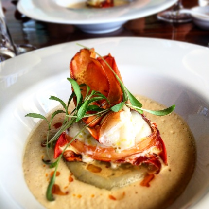 Lobster medallion with blue swimmer crab and prawn ravioli and lobster bisque
