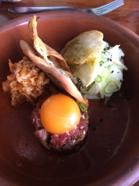 Korean beef tartare with raw egg yolk, spring onion pancake, kim chi, nashi pear and toasted ppang