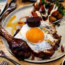 500g 40 day dry-aged Hereford rib eye on the bone with egg and black pudding