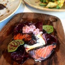 Squid ink ocean trout with horseradish crème fraiche and beetroot, lemon myrtle tapioca