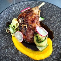 Confit five spiced duck leg with orange and carrot puree and tamarind caramel from Glass House, Hobart