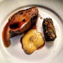 Roasted pork loin, black pudding, walnut and potato crumb, fennel, mustard