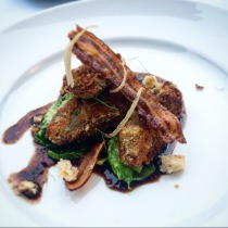 Almond and parmesan crumbed chicken livers, preserved lemon, pancetta, olive, Brussel sprout leaves