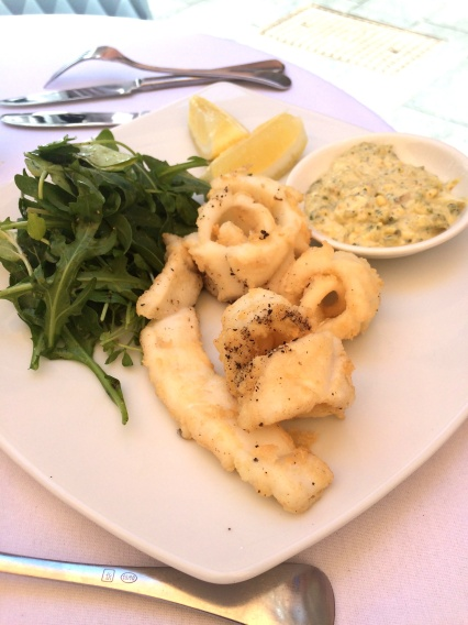 Calamari Fritti - crisp fried fresh local calamari with a watercress, wild rocket, snow pea salad, fresh lemon & house made tartare