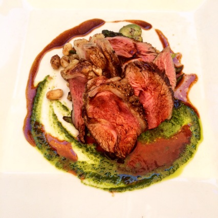 Agnello al Forno - oven roasted lamb rump with broad beans, asparagus, cannellini beans, tomato & rocket-mint pesto