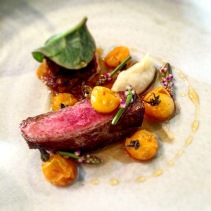 Aged beef, jus roasted tomatoes, tomato honey, fermented potato and Malabar spinach and flowers