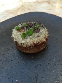 Emu tart with warm jersey milk and white geranium
