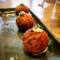 Fried balls of unagi, cod, fungi and reggiano