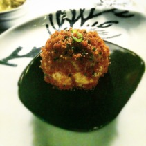 King prawn mousse rolled in pangrattato on squid ink sauce
