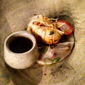 BBQ reef bug, veal and ginger dumplings, tendon, xo consommé and pickled shallots