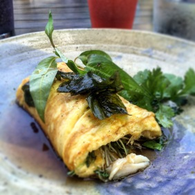 North Queensland mud crab omelette, greens, ginger caramel and white pepper broth