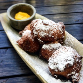 Cider donuts with cinnamon sugar and passionfruit curd