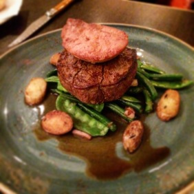 Black Angus filet with duck fat potatoes, sautéed greens, speck and home made jus