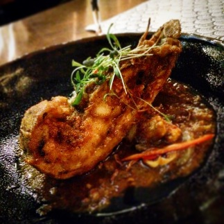 Bug tail pan fried in a seafood spice paste with baby corn and spring onion