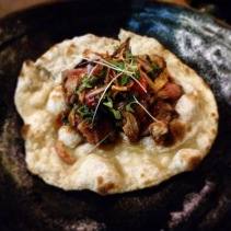 Street beef naan - grilled tenderloin with tamarind, smoked chilli chutney, coriander and spring onion