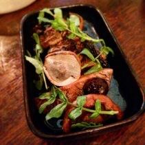 Mushrooms with beef jus, wild garlic and raisin gel