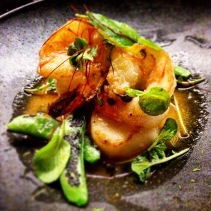 Sea scallops and king prawns with sugar snap peas, Sancho peppercorn and sudachi prawn butter