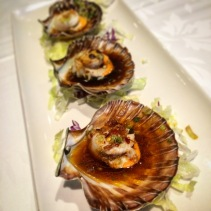 Steamed scallops done three ways