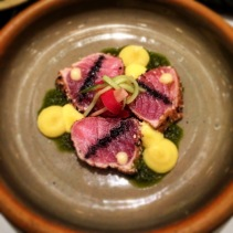 Sesame-seared tuna, sweetcorn and ginger puree, pickled carrot, chive oil