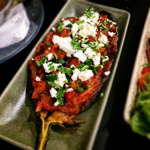 Eggplant pouch with onion, homemade tomato sauce and feta
