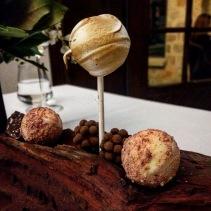 Passionfruit meringue pie, seeded chocolate, nectarine pop, wattle seed crunch