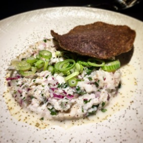 Ceviche with coconut cream, spring onion, lime, chilli, coriander topped with a crunchy tortilla of amaranth and chia